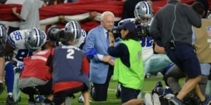 Jerry Jones kneeling